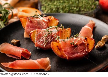 Delicious And Healthy Dish Grilled Peach With Prosciutto, Capers, Microgreen, Food Recipe Background