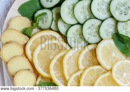 Sassi Water, Cooking Ingredients For Making Sassi Drink: Lemon, Cucumbers, Ginger Root, Mint On A Ro
