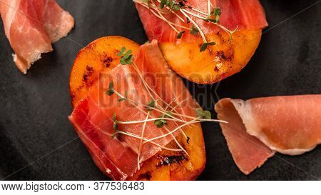 Delicious Snack Grilled Peach With Prosciutto, Microgreen, Food Recipe Background.