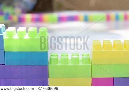 Colorful Plastic Block Puzzle Is A Toy For Children. Helps To Have Fun And Strengthen The Imaginatio