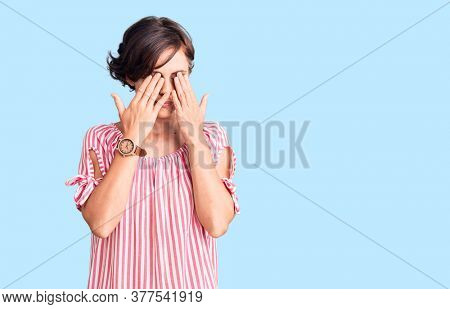 Beautiful young woman with short hair wearing casual summer clothes rubbing eyes for fatigue and headache, sleepy and tired expression. vision problem