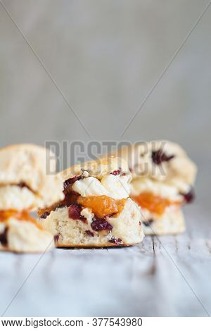 Traditional Fresh Baked English Cranberry Or Cherry Tea Scones With Clotted Cream And Peach Butter J