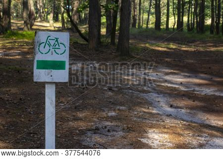 Bikeway In The Forest. Wooden Road Sign