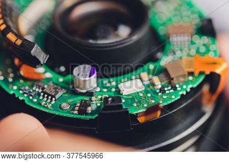 Big Professional Digital Camera Lens Dissassembly Process.demounted Broken Dslr Optics On Table In W