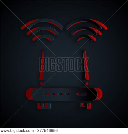 Paper Cut Router And Wi-fi Signal Icon Isolated On Black Background. Wireless Ethernet Modem Router.