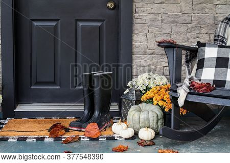 Traditional Style Front Porch Decorated For Autumn With Rain Boots, Heirloom Gourds,  White Pumpkins