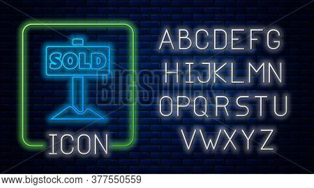 Glowing Neon Hanging Sign With Text Sold Icon Isolated On Brick Wall Background. Sold Sticker. Sold