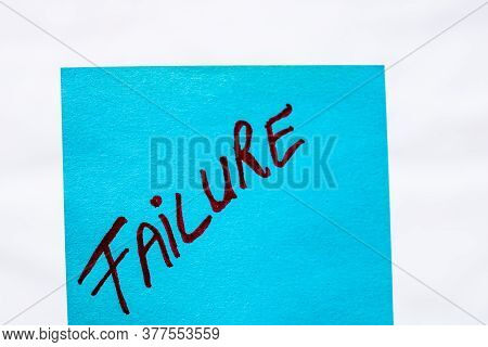 Failure Handwriting Text Close Up Isolated On Blue Paper With Copy Space. Writing Text On Memo Post