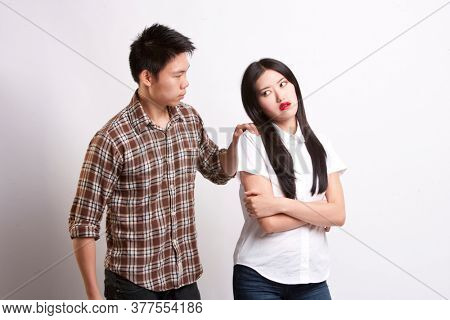 Young man convincing beautiful woman over white background