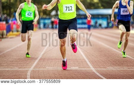Winning Finish Man Runner Athlete Sprint Race At Stadium