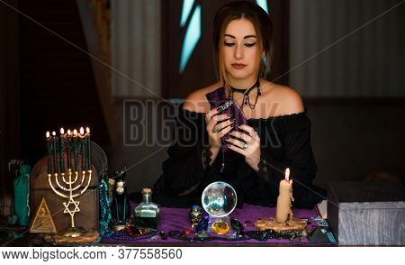 Woman Fortune Teller On A Tarot Cards, Concept Of Predictions, Magical Rituals And Wicca Elements On
