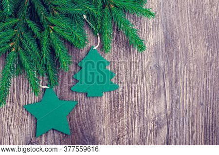 Christmas And New Year Composition. Green Spruce Branches With Decoration On A Dark Wooden Backgroun