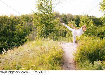 Happy Lady Practicing Yoga, Standing In Warrior Three Exercise, Virabhadrasana Iii Pose. Athletic La