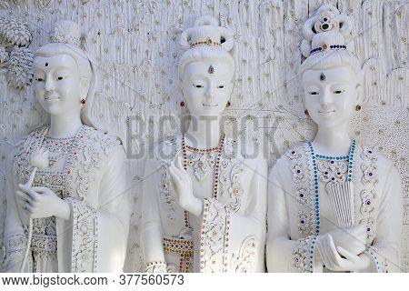 Chiang Rai, Thailand - November 15, 2019: Bas-relief With Three Girls - Decoration Detail Of Wat Hua