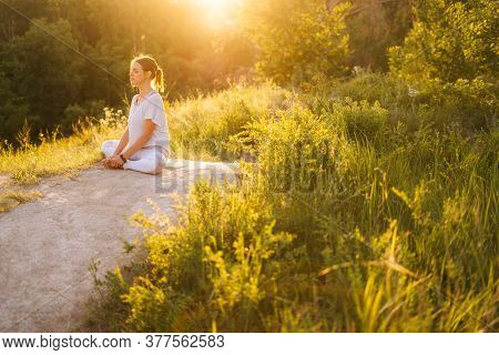 Full Peace And Tranquillity Meditative Young Woman Meditating Sitting In Lotus Position With Closed