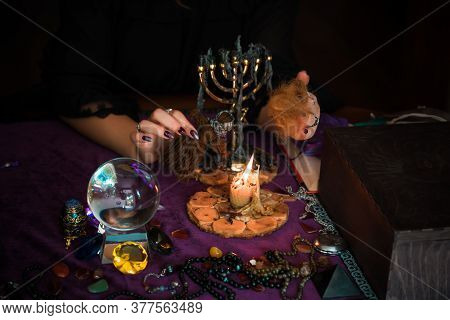 Woman Make A Rituals With A Hair And Voodoo Doll , Concept Of Magic Rituals And Wicca