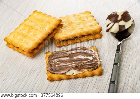 Sandwiches From сrackers With Chocolate-dairy Paste, Teaspoon With Paste On Light Wooden Table