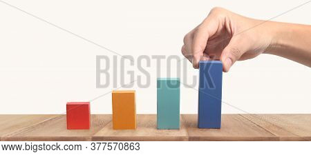 Hand Arranging Wood Block Stacking As Chart. Business Concept Growth Success Process