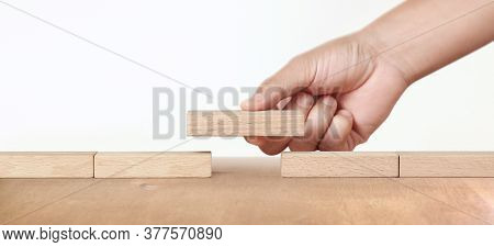 Hand Placing A Wooden Block, Planning Of Project Management In Business