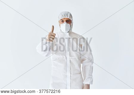Doctor In Protective Medical Suit Showing Thumbs Up. Success Concept