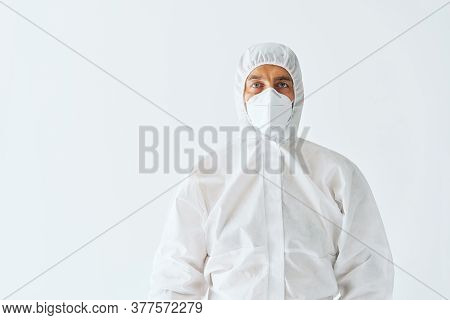 Man In Protective Medical Suit With Copy Space. Virus Concept