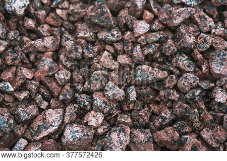 Abstract Image Of A Pile Of Rubble Made Of Pink Granite. Material For Construction.