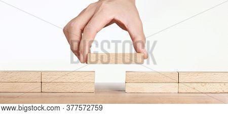 Hand Placing Wooden Block, Planning Of Project Management In Business