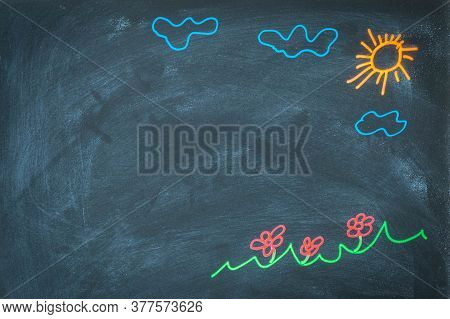 Colored Chalk Drawing On Blackboard For Back To School Concept. Top View Of Chalkboard With Sun, Clo