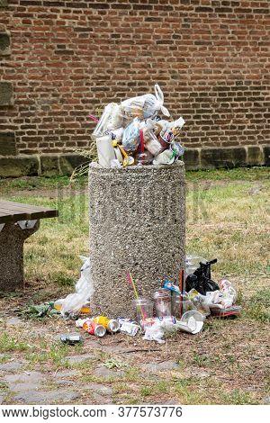 Terezin, Czech Republic - June 3, 2018: Stone Dustbin Full Of Garbage Which Has Not Been Emptied. Du