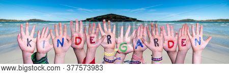 Children Hands Building Word Kindergarden, Ocean Background