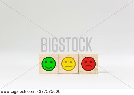 Emotional Face On Wooden Block Cube On White Background, Excellence, Good, Bad. The Best Excellent B