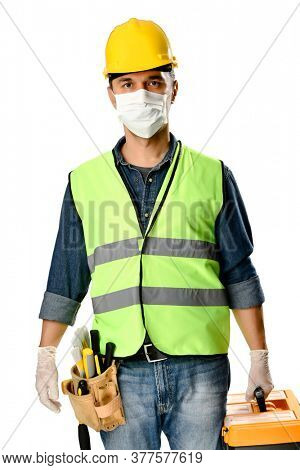 Manual worker with tool bag wearing protective face mask and gloves to avoid Coronavirus epidemic isolated on white background