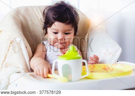 Cute Little Girl Learn Eating Sweet By Herself At First Time And Inquisitive Of Dirty Hand, Lovely T