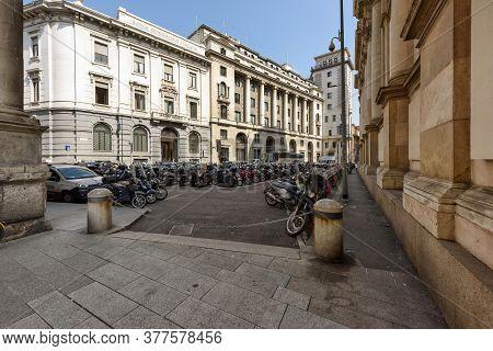 Milan, Italy - April 17, 2018. Largo Raffaele Mattioli Street. View At Church Of St. Fedele And Pala