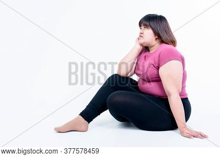 Portrait Images Of Fat Woman Sitting And She Is Sad Because Of Her Fatness, On White Background, To