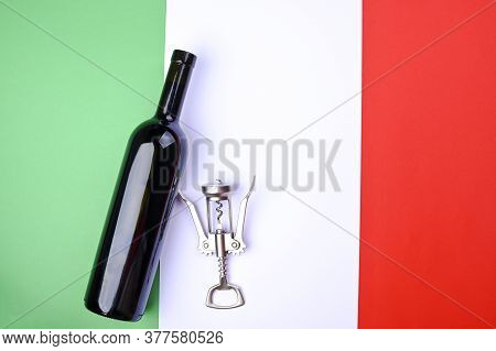 Wine Bottle And Corkscrew On The Italian Flag. The Concept Of A Winemaker And A Traditional Harvest