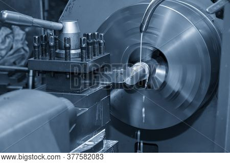 The Operation Of Lathe Machine Cutting The Metal Shaft Parts With The Cutting Tools. The Metalworkin