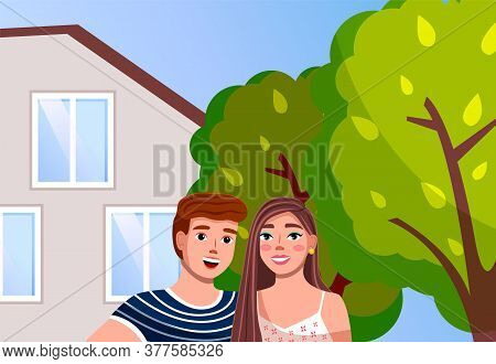 Couple Man And Woman At The Modern Family Villa House With Green Trees In The Home Garden. Smiling L