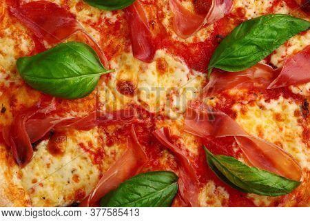 Proscuitto Pizza Background With Meat And Mozzarella Closeup Top View.