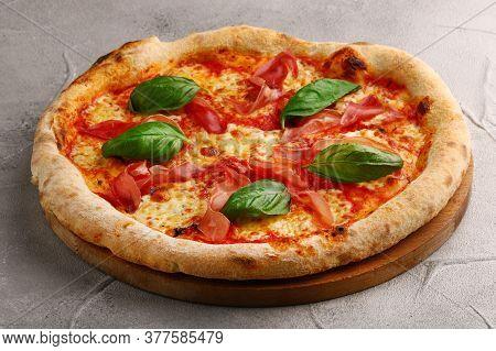 Pizza Prosciutto With Basil And Mozzarella Closeup On Light Concrete Or Stone Background