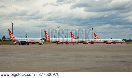 Kyiv, Ukraine - July 14, 2020: Passenger Plane Skyup Airlines. Orange Airplane Boeing 737-800 On The
