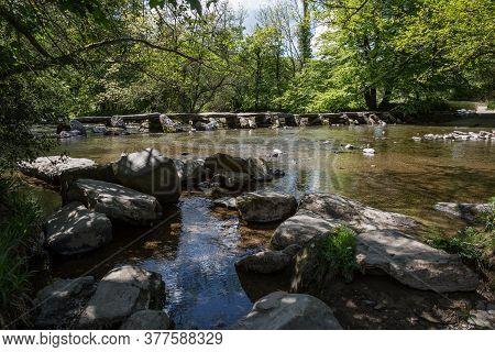 Tarr Steps Clapper Bridge Across River Barle In Exmoor National Park, Somerset Uk