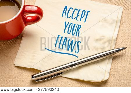 accept your flaws inspirational advice - handwriting on a napkin with a cup of coffee, mindset and personal devleopment concept