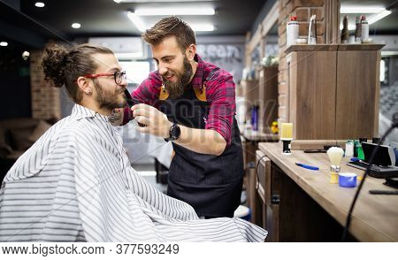 Happy Young Handsome Man Visiting Hairstylist In Barber Shop Salon