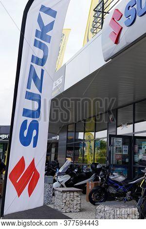 Bordeaux , Aquitaine / France - 07 17 2020 : Suzuki Dealership Motorbike Car Sign And Logo On Flag O
