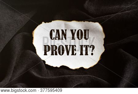 Burnt White Piece Of Paper With Text Can You Prove It On A Black Fabric Background
