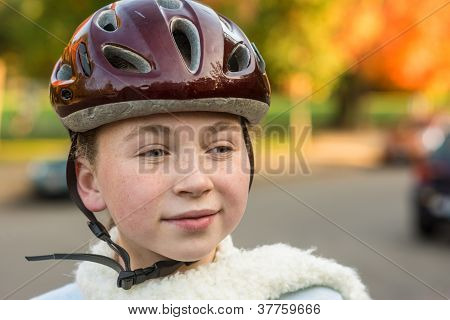 Young Girl In Fall Wearing Bicycle Helmet
