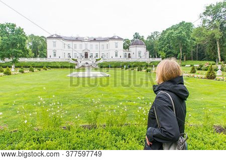 Palanga, Lithuania - July 5 2020: Blond Girl Visiting The Park Of Amber Museum In Palanga, Lithuania