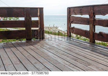 Wooden Railing With Wooden Floor On The Background Of The Reservoir