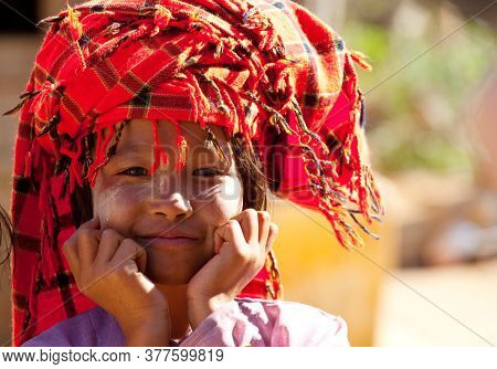 INLE LAKE, MYANMAR - FEBRUARY 2, 2011: Unidentified Pa-O tribe girl  in traditional colourful clothing in Inle lake area, Shan State, Myanmar (Burma).